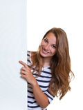 Young woman pointing to a signboard royalty free stock images