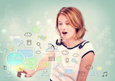 Young woman pointing to social media concepts Stock Photos