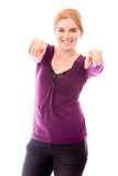 Young woman pointing towards camera with both hands Stock Images