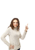 Young woman pointing towards open space Royalty Free Stock Photo