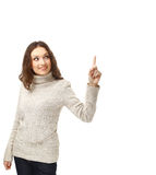 Young woman pointing towards open space Royalty Free Stock Image