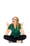 Young woman pointing up Stock Photography