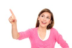 Young woman pointing up Stock Photos