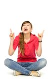 Young woman pointing up Stock Photo