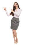 Young woman pointing up Stock Image