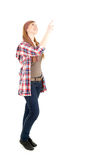 Young woman pointing up, full lenght Stock Image