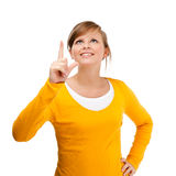 Young woman pointing up Royalty Free Stock Photo