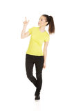 Young woman pointing up. Royalty Free Stock Images