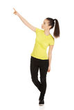 Young woman pointing up. Royalty Free Stock Photography