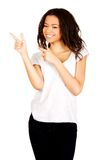 Young woman pointing up. Stock Photography