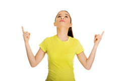 Young woman pointing up. Stock Image