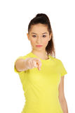 Young woman pointing on you. Stock Photography