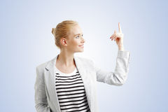 Young woman points out Royalty Free Stock Photo