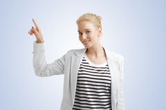 Young woman points out Royalty Free Stock Photos