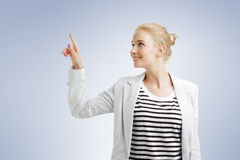 Young woman points out Stock Photos