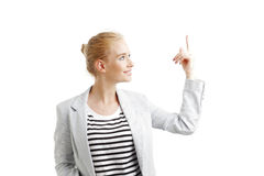 Young woman points out Stock Photo