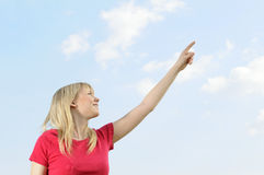 Young woman points the sky Royalty Free Stock Images
