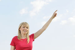 Young woman points the sky Stock Photos