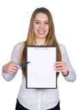 Young woman points to a clipboard with a pen Stock Photography