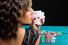 Young woman with poker cards stock photography