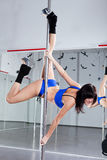 Young woman with pole Royalty Free Stock Image