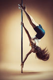 Young woman pole dancing Royalty Free Stock Images