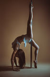 Young woman pole dancing Stock Image
