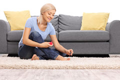 Young woman polishing her toenails Stock Images
