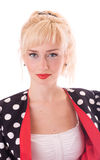 Young woman in Polka dot coat Stock Photography