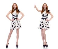 The young woman in polka dot dress isolated on white royalty free stock images