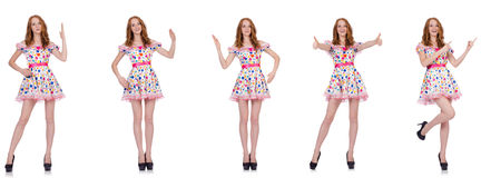 The young woman in polka dot dress isolated on white Stock Images