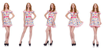 The young woman in polka dot dress isolated on white Royalty Free Stock Photography