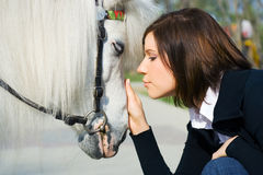 Young woman and pony. Stock Photos