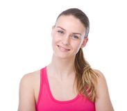 Young woman with ponytail smiling Stock Images