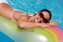 Young woman in the pool Stock Photos