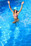 Young woman in the pool Royalty Free Stock Image