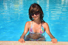 Young woman on a pool Royalty Free Stock Photo