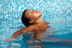 Young woman at a pool Stock Images
