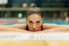 Young woman in the pool Stock Photography