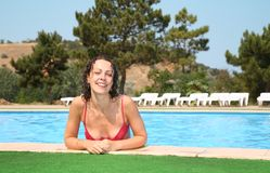 Young woman at the pool Stock Images