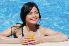 Young woman at a pool Royalty Free Stock Photography