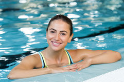 Young woman in pool Royalty Free Stock Image