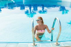Young woman in pool Stock Image