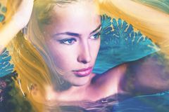 Young woman in pool portrait creative double exposure Royalty Free Stock Photo