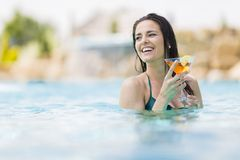 Young woman in the pool. Pretty young woman in the pool Royalty Free Stock Photo