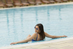 Young woman in the pool Royalty Free Stock Photo