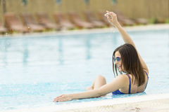 Young woman in the pool Royalty Free Stock Photos