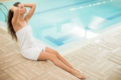 Young woman by the pool Royalty Free Stock Images