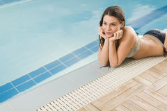 Young woman by the pool Royalty Free Stock Photos