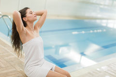 Young woman by the pool Stock Photo